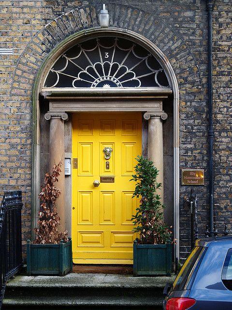 Bright Yellow Door With Grey Brick House