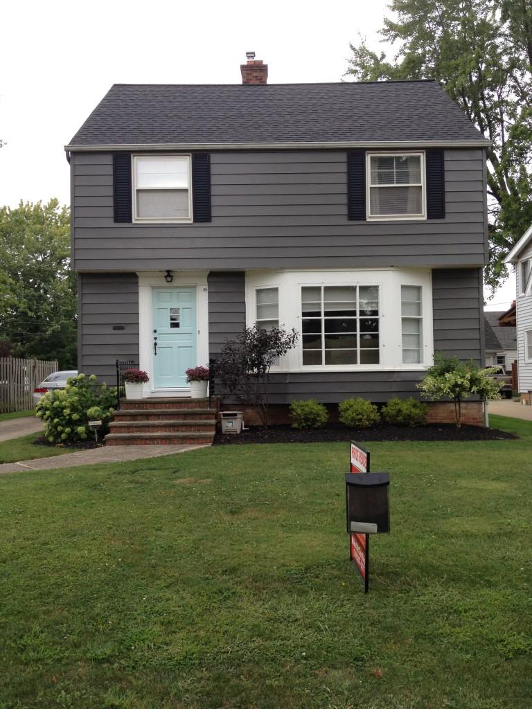 Gray House White Trim Black Shutters 768x1024