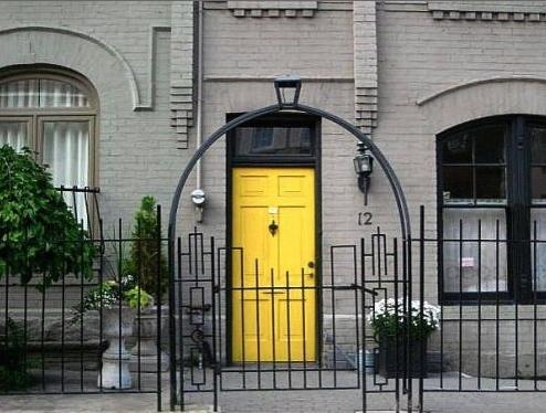 Grey Home Paint And Yellow Golden Door Front Side